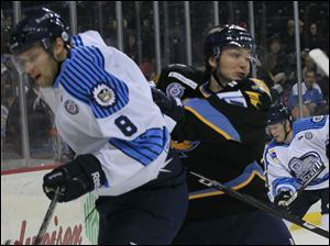 The Icemen's Tyler Miller, left, is pushed aside by Toledo's Adam Hobson in the first period.