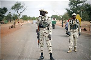 Soldiers patrol about 385 miles north of Mali's capital, Bamako.  French and Malian troops on Sunday held a bridge and airport in the town of Gao.