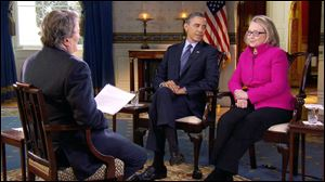 "President Obama, center, and Secretary of State Hillary Rodham Clinton speak with ""60 Minutes"" correspondent Steve Kroft, left, in the Blue Room of the White House in Washington. The interview aired Sunday during the ""60 Minutes"" telecast on CBS."