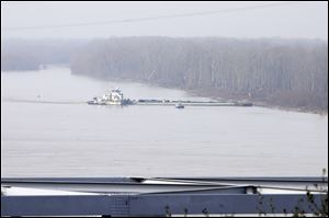The towboat Nature Way Endeavor banks a barge against the western bank of the Mississippi River on Sunday. The river was closed to all traffic eight miles north and south of Vicksburg.