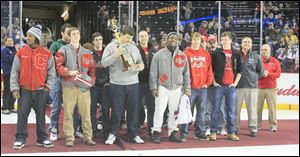 The Central Catholic High School football team was honored with an on-ice ceremony before the start of the Walleye game. The team showed off its state title trophy and dropped the ceremonial first puck.