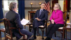 In this image taken from video, President Obama and Secretary of State Hillary Clinton speak with correspondent Steve Kroft during an interview for CBS' '60 Minutes.'