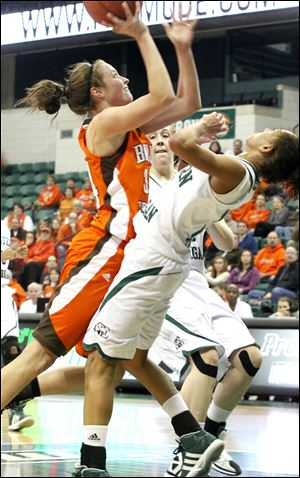 Bowling Green's Bailey Cairnduff shoots over Eastern Michigan's Desyree Thomas on Sunday. The freshman led BG with 18 points.