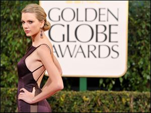 Singer Taylor Swift this month at the 70th Annual Golden Globe Awards, shows bolder choices in attire.