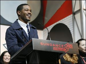"Director Ryan Coogler accepts the U.S. Dramatic Audience Award for the film ""Fruitvale"" during the 2013 Sundance Film Festival Awards Ceremony in Park City, Utah."