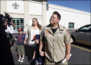 In this 2012 photo, Jennifer Tyrrell, right, arrives for a meeting at the Boys Scouts of America national offices in Irving, Texas, with her son Jude Burns, 5, second from right, partner Alicia Burns, and son Cruz Burns, 7, left. The Ohio woman was ousted as a den mother because she is a lesbian.