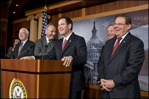 A burst of laughter erupts during a news conference where a bipartisan group of leading senators announce that they have reached agreement on the principles of sweeping legislation to rewrite the nation's immigration laws. From left are Sen. John McCain, R-Ariz., Sen. Charles Schumer, D-N.Y., Sen. Marco Rubio, R-Fla., Sen. Dick Durbin, D-Ill., and Sen. Robert Menendez, D-N.J.