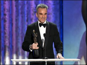 "Daniel Day-Lewis accepts the awards for outstanding male actor in a leading role for ""Lincoln"" at the 19th Annual Screen Actors Guild Awards on Sunday at the Shrine Auditorium in Los Angeles."