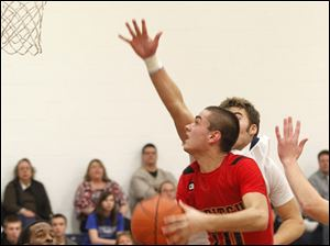 Toledo Christian's Ben Ivan guards Cardinal Stritch's Joey Cousino.