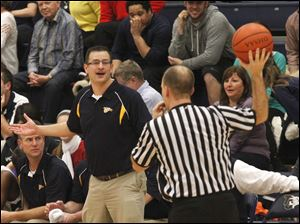 TC head coach Dave McWhinnie questions a call from the ref.