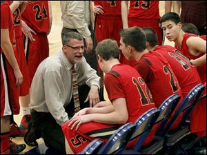 Cardinal Stritch head coach David Rieker instructs his players during a timeout.