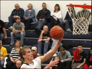 Toledo Christian's Eric Celler drives to the basket for two of his game-high 31 points.