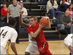 Cardinal Stritch's Joey Cousino drives past TC's Garshawn Paynther.