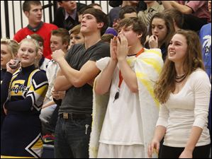 Toledo Christian fans cheer for their team against Cardinal Stritch.