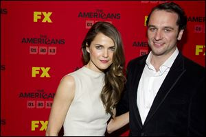 "Keri Russell and Matthew Rhys attend the premiere of the FX television series ""The Americans."""