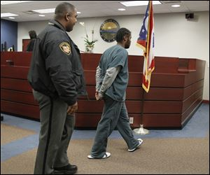 Titus Crittendon heads back to juvenile detention following a hearing in Lucas County juvenile court on Nov. 26.