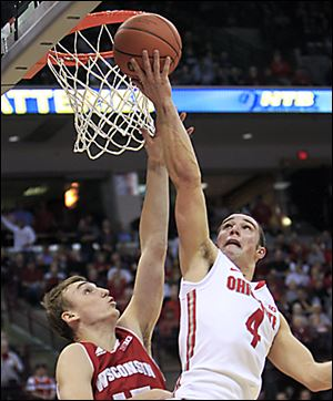 Ohio State's Aaron Craft shoots over Wisconsin's Sam Dekker during the second half of Tuesday's game in Columbus. Craft finished with 13 points.
