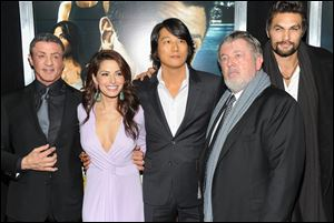 Walter Hill, second from right, continued to produce movies for other people, but seemed destined never to direct another one himself. Then Sylvester Stallone, left, called.