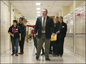 Bill Hilt leads a group of nine administrators and educators from China on a tour of Perrysburg Jr. High.