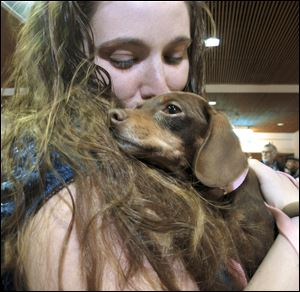 Mandi Smith, of Fort Campbell, Ky., is reunited with her dog, Pooka, today at the Albuquerque International Sunport Airport in Albuquerque, N.M.