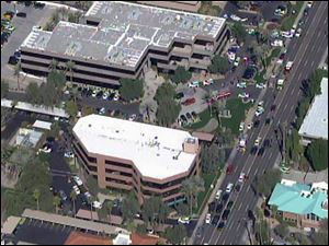 This frame grab provided by abc15.com shows the scene at a Phoenix office complex where police say someone shot at least three people today.