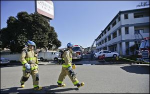Investigators were trying to determine whether there was a drug lab inside, authorities said.  Three people were taken to a hospital to be treated for burns and one was in serious condition, said San Diego Fire-Rescue Department spokesman Maurice Luque.