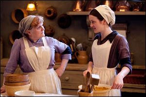From left to right: Lesley Nicol as Mrs. Patmore and Sophie McShera as Daisy.
