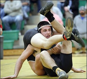 Clay's Ed Silva defeats Perrysburg's Kadin Llewellyn in the 195-pound match. Silva won 13-0.