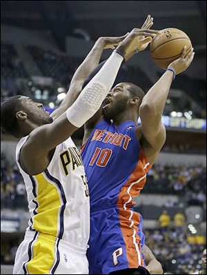 The Pistons' Greg Monroe puts up a shot against the Pacers' Roy Hibbert during the first half of Wednesday's game. Monroe finished with 18.