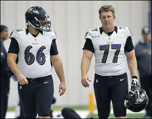 Gino Gradkowski, left, walks with Baltimore teammate Matt Birk. The rookie center, the brother of former UT standout Bruce Gradkowksi,  was drafted by the Ravens in the fourth round.