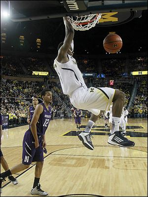Michigan forward Glenn Robinson III dunks against Northwestern on Wednesday. Robinson scored 13 points on 6-of-7 shooting.