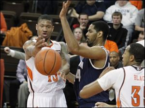 BGSU's A'uston Calhoun passes through hands of Akron's Zeke Marshall during their game at the Stroh Center at BGSU in Bowling Green.