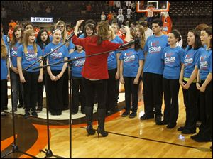 The Springfield Concert Choir performs the National Anthem for the game against Akron.