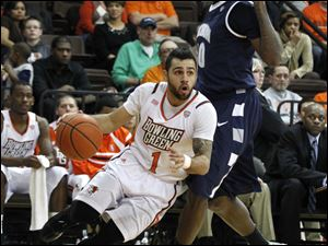 BGSU's Jordon Crawford dribbles around Akron's Nick Harney.