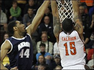 Akron's Zeke Marshall reaches and misses a shot by BGSU's A'uston Calhoun.