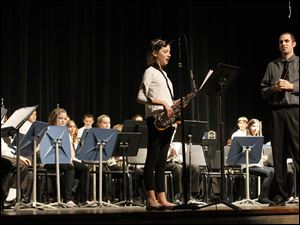Betsy Wagner, 12, carried her saxophone up to the microphone while introducing the next piece her band would play.