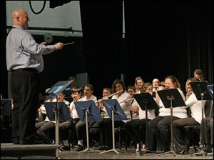 Band director Jason Jordan, left, smiled as he conducted a group of students and faculty.