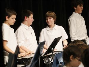 Noah Pauley, 11, center left, joked with his fellow band mates at the end of the concert.