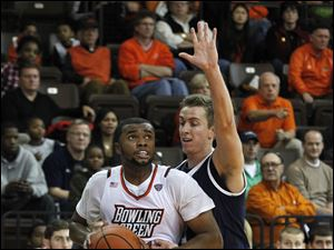 BGSU's Chauncey Orr dribbles around Brian Walsh.