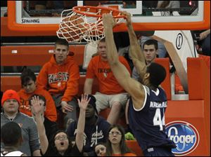 BGSU's Craig Sealey watches Akron's Zeke Marshall dunk.