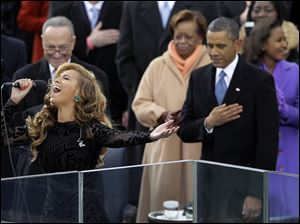 President Barack Obama stands with his hand over his heart as Beyonce performed the national anthem at the ceremonial swearing-in at the U.S. Capitol during the 57th Presidential Inauguration in Washington.