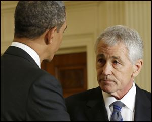 President Barack Obama shakes hands with Defense Secretary-nominee, former Nebraska Sen. Chuck Hagel, in the East Room of the White House in Washington.
