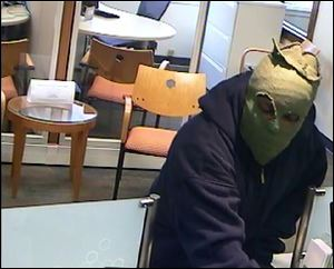 A masked man robs a Huntington Bank in Northwood.