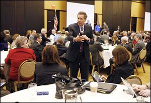Ohio Gov. John Kasich leaves the podium as he speaks at a special meeting of the Buckeye Association of School Administrators on Thursday in Columbus.