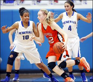 Southview's Emily Westphal drives past Anthony Wayne's Jasmine Bonivel during the Cougars'56-49 victory on Thursday. Westphal finished with 12 points for Southview.