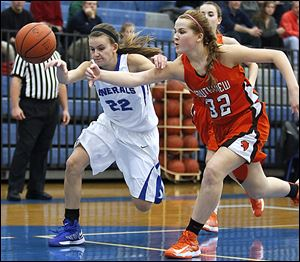 Southview's Taryn Stanley, right, knocks the ball away from  Anthony Wayne's McKenzie Krieg  during the Cougars' 56-49 victory over the Generals on Thursday night. Stanley led Southview with a game-high 20 points as the Cougars improved to 9-2 in the NLL.