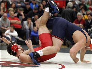 Ohio State University wrestler Peter Capone, left, scores an escape from University of Illinois wreslter Chris Lopez.