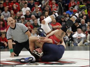 Ohio State University wrestler Cody Magrum battles University of Illinois wrestler Tony Dallago for a takedown.