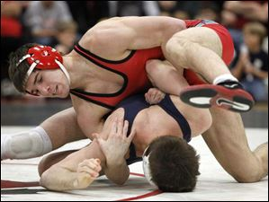 Ohio State University wrestler Hunter Stieber looks to score back points on University of Illinois wrestler Stephen Rodrigues.