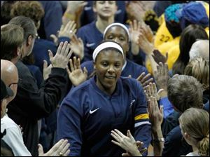 University of Toledo player Yolanda Richardson leads the Rockets through the tunnel before playing Ohio University at Savage Arena.